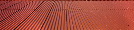 Wide aspect image of red corrugated metal roof Stock Photo - 8709237