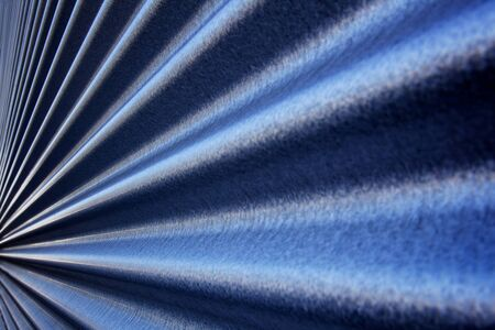 Blue steel metallic corrugated wall converging to a point
