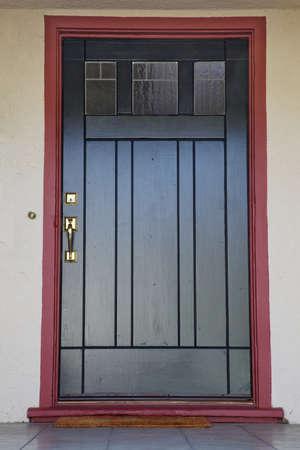 Craftsman deco style black wood door with burgundy trim