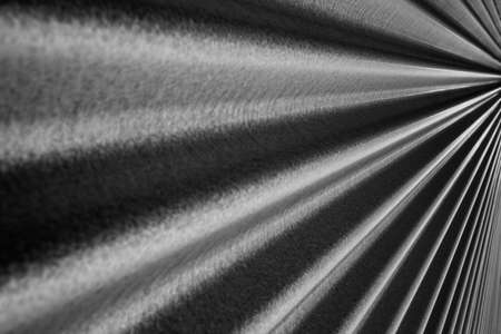 Black and white image of a steel metallic corrugated wall converging to a point on the right Stock Photo - 8923382