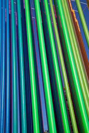 Mulit-color pipes reaching for the sky as part of a paint shop display photo