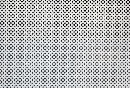 Plaque de métal blanc avec de nombreux petits trous circulaires Banque d'images - 9012022
