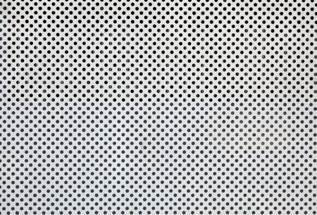 perforated: White metal plate with many small circular holes Stock Photo