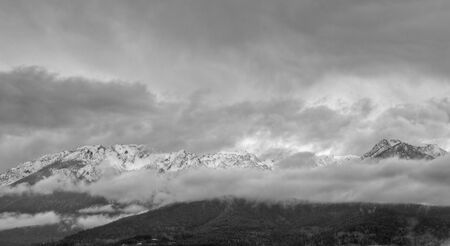 Black and white image of part of Hurrican ridge of the Olympic Mountains on a cloudy day photo