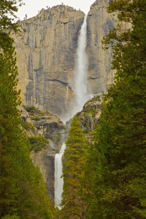 Upper and lower Yosemite falls with a powerful spring water flow in vertical composition photo