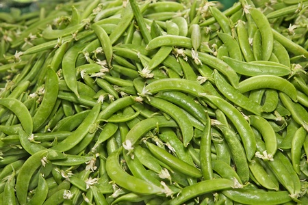 Pile of green Snap peas at the farmers market photo