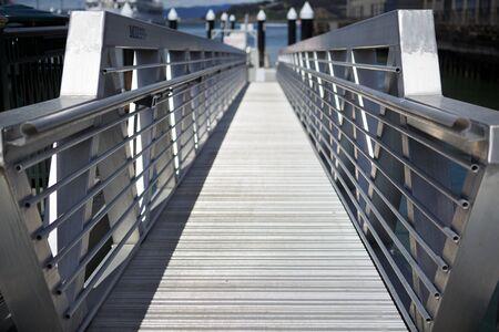 Marina aluminum boarding ramp in diminishing perspective