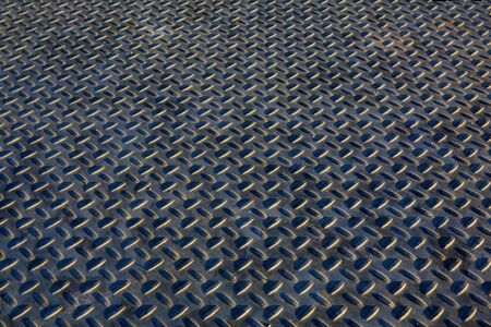 hued: Blue hued steel treaded grating walk way Stock Photo