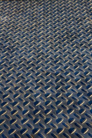 shiny metal background: Blue hued steel treaded grating walk way Stock Photo