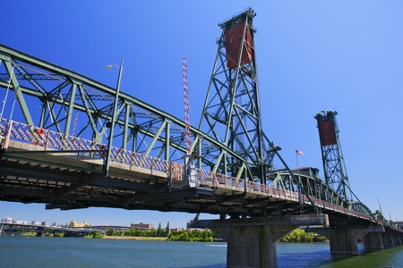 Old Green and red Portland draw bridge against a deep blue sky