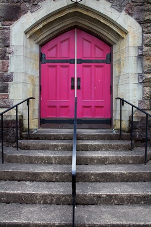 Steps leading to the double Fuschia  Doors of a Catholic church with a stone triangle feature photo