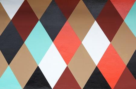 六つの着色されたダイヤモンド塗られた壁の模様 写真素材