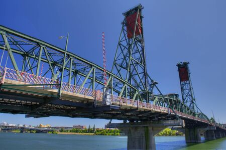 HDR image of Old Green and red Portland draw bridge against a deep blue sky
