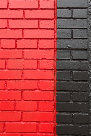 Verticle image of black and red painted brick wall