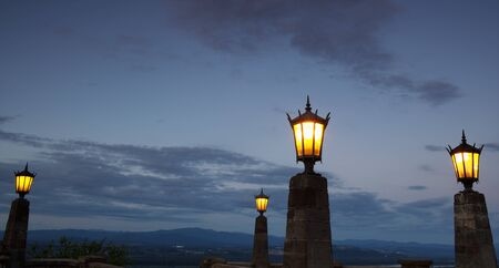 streetlamp: Four Old City Lights against the end of a Portland sunset