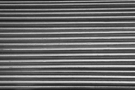 Horizontal pile of small diameter galvanized steel pipe photo
