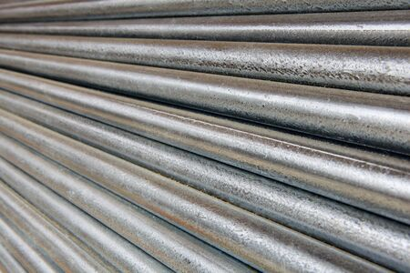 diminishing: Pile of shiny galvanized steel pipe diminishing from right to left