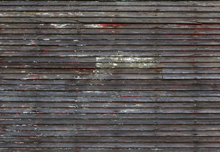 hints: Worn and eroded wood wall with hints of previous paint Stock Photo