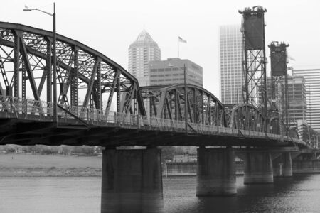 Foggy day with a diminishing view of the Hawthorne Bridge on the Williamette River in Black and White