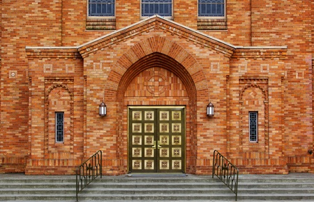 Green brass doors and orange brick facade of the front of a Greek Orthodox Church Stock Photo - 12686796