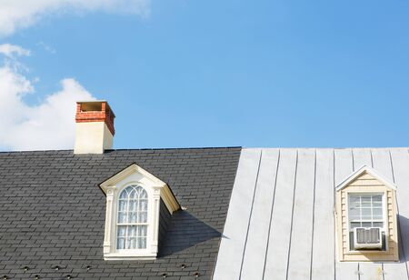 attic: Two Windows and a Chimney on two continuous house roofs