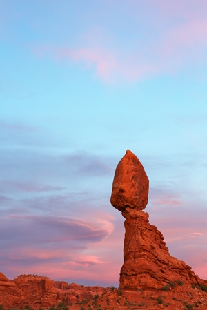 Arched park balancing rock at end of sunset against dramatic sky Stock Photo - 13849044