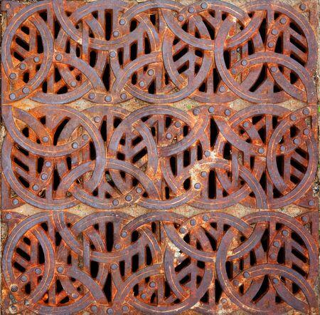 design: Rusty iron Celtic design storm Grating Stock Photo