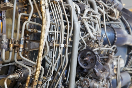 The complicated plumbing of tubing inside a jet engine