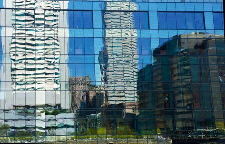 distort: Uneven windows distort city skyline reflections Stock Photo