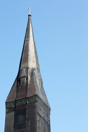 Cuus black net shrouded Christian church steeple against blue sky Stock Photo - 14039121