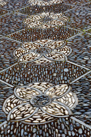 Intricate pathway of an Asian stone mosaic patio photo