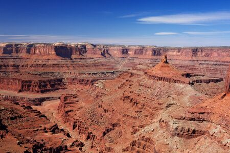 View looking into Dead Horse Canyon with blue sky photo
