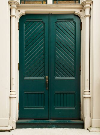 Colonial style Colonial Green Door on white house Stock Photo - 16697136