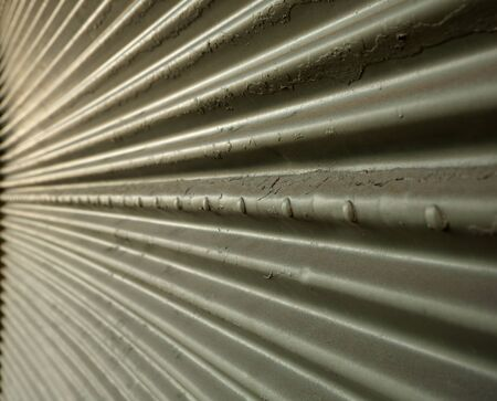 Corrugated steel wall in perspective leading to a point