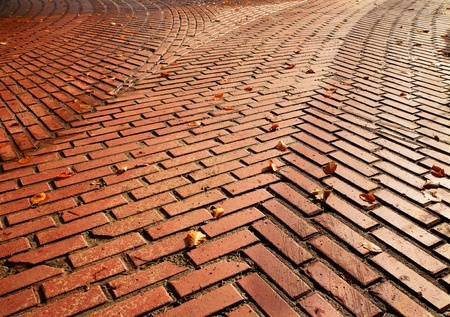 Red brick road split into two directions with herringbone pattern requiring a decision photo