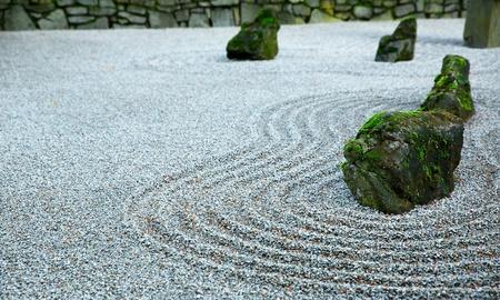 Zen Garden on Dark day with moss covered rocks Banco de Imagens