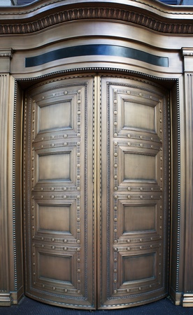large doors: Large curved brass closed doors on a bank entrance