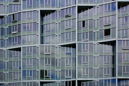 Irregular shapes of an office building facade of windows