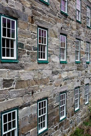 Two rows of windows on an old stone  building