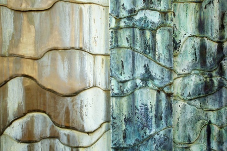 Concrete white, tan, blue, and green weathered Abstract flowing wall