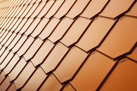 Unusual rows of a copper tile wall in perspective
