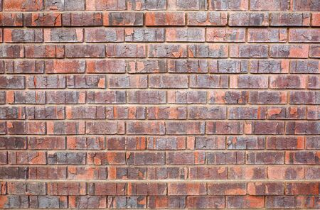 Manufactured red Faux used brick wall