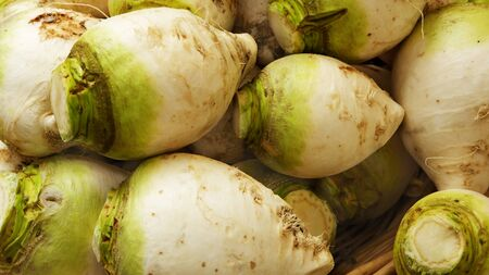 Pile of Green and white turnips at the farmers market