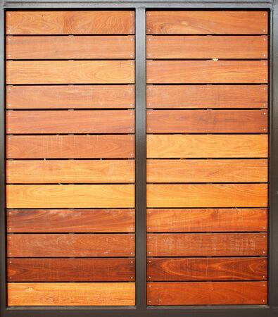 Stained wood framed in steel garage doors vertical Banco de Imagens