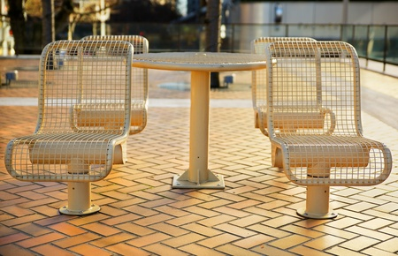 Tan color City Metal Picnic Seats all pointed toward viewer