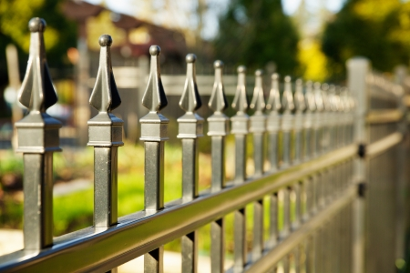 iron fence: Pointed metal fence perspective with a narrow depth of field