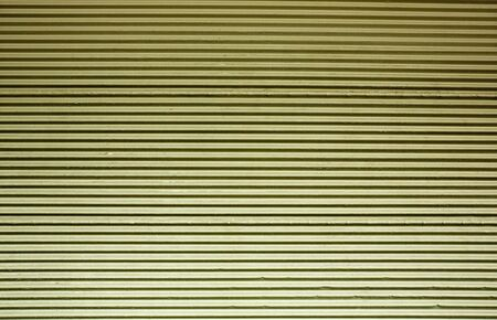 durable: Horizontal corrugated steel wall with a green tint