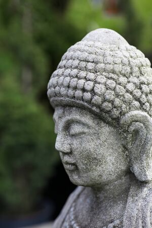 Asian Stone Statue Portrait with soft focus background Banco de Imagens - 21498280