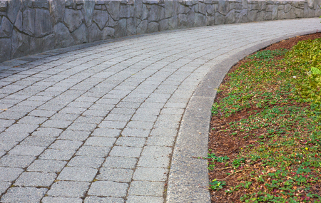 Curved stone path with stone wall Banco de Imagens - 22427000