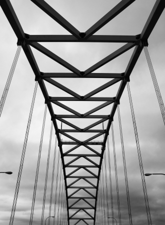 Portlands Fremont Bridge black and white image against a cloudy sky